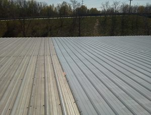 Before and after West Roofing Systems performs silicone restoration on Honeywell Claymont building