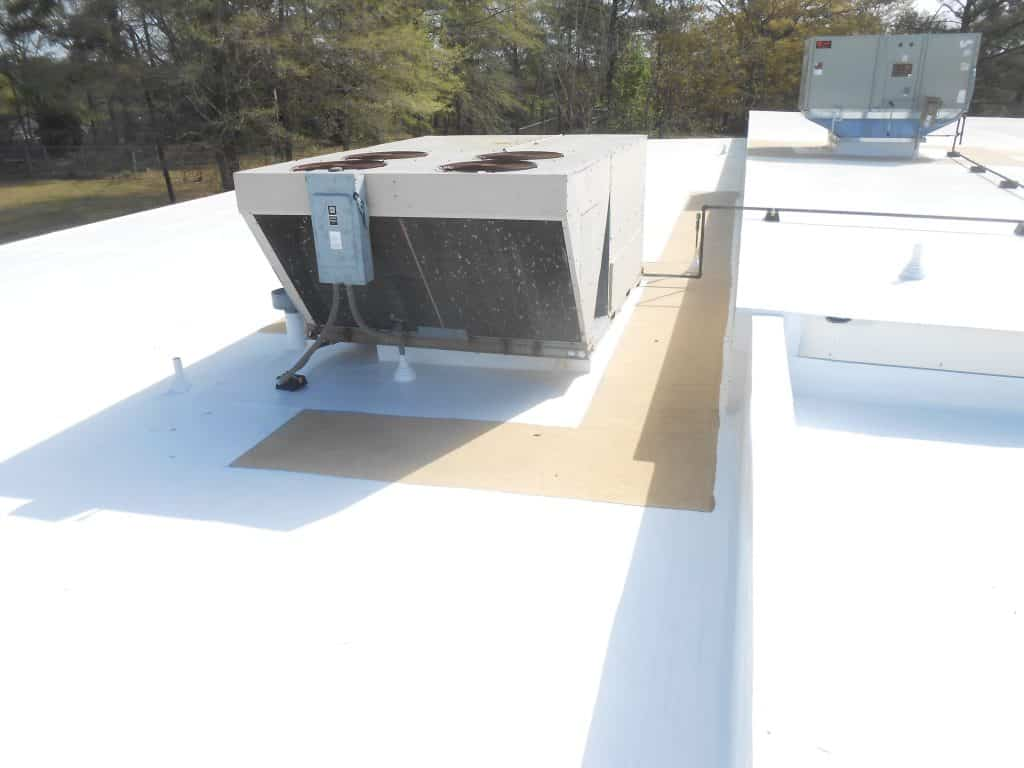 Photo of a spray foam walkway developed to guide a technician to the HVAC unit.