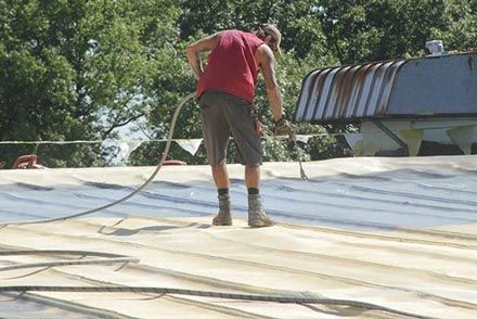 Spray foam over commercial metal roof