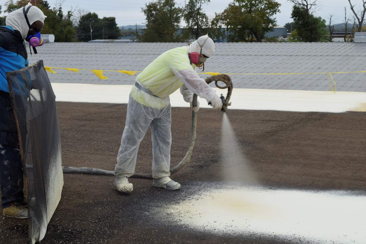 spray foam being sprayed on a roof