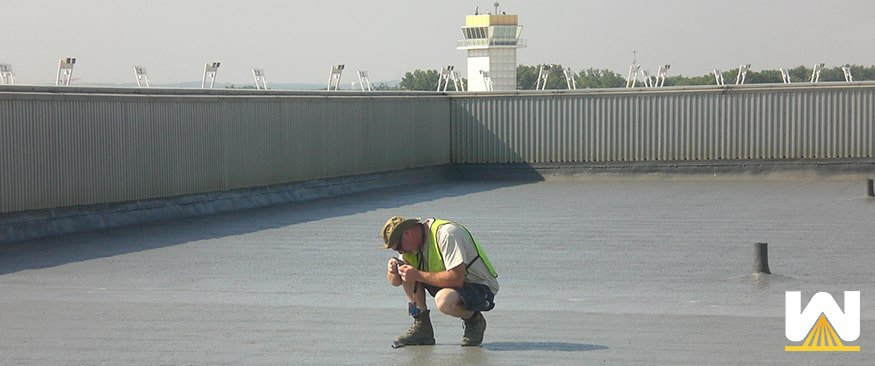 Roofing contractor inspecting a roof