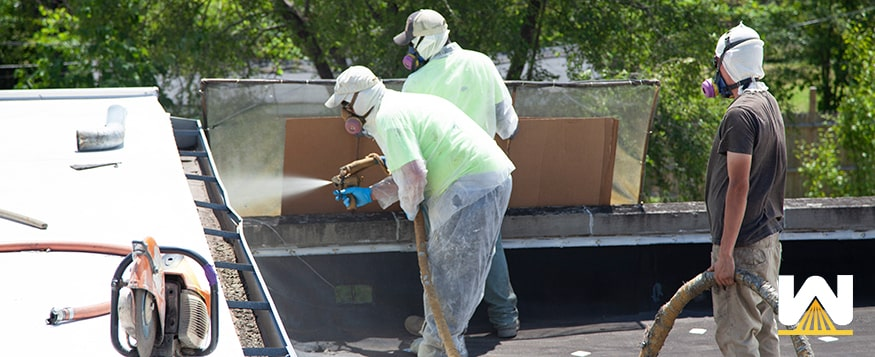 roofers installing a spray foam roof
