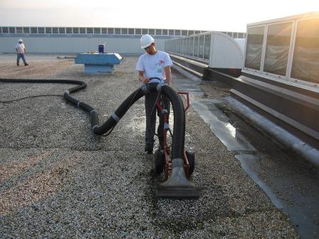 removal of gravel on a roof before coating can be applied