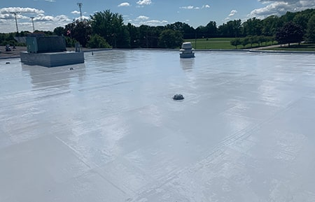 seamless silicone roof coating on commercial roof