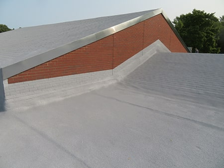 seamless spray foam roof on a commercial building