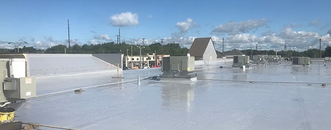 silicone roof coating on a commercial roof