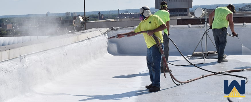 silicone roof coating over a gravel surfaced roof