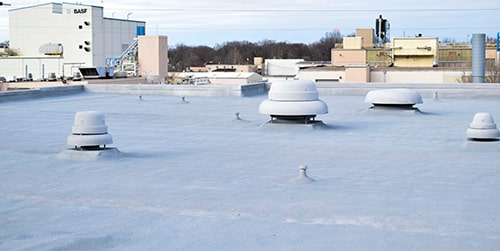 photo of a spray foam roof on a commercial building
