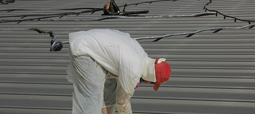 silicone coating on a metal roof