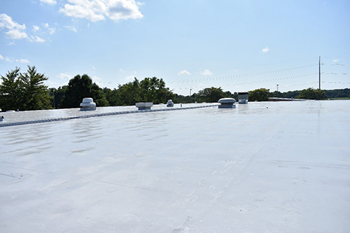 EPDM roof restored with silicone coating