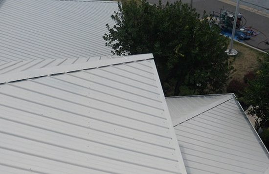 silicone coating over a metal roof