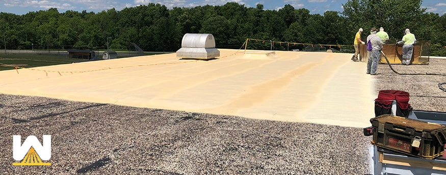 re-roofing a commercial building by using spray foam