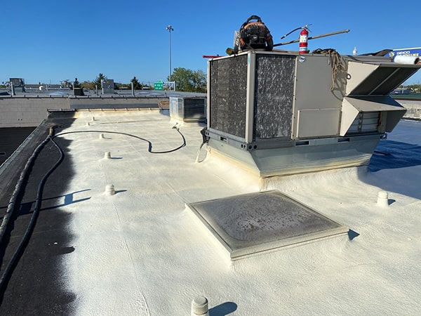 spray foam over smooth built-up roof