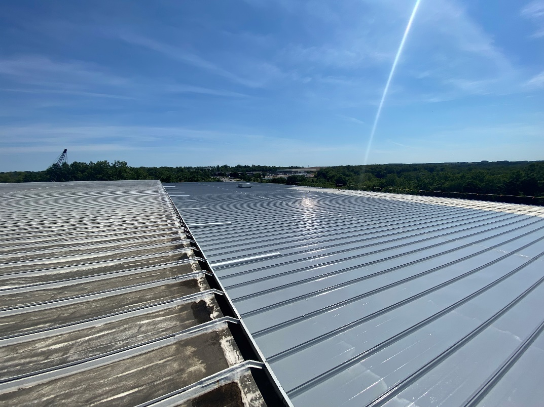 An in-progress photo of a roof coating system installed at Artiflex in 2021.