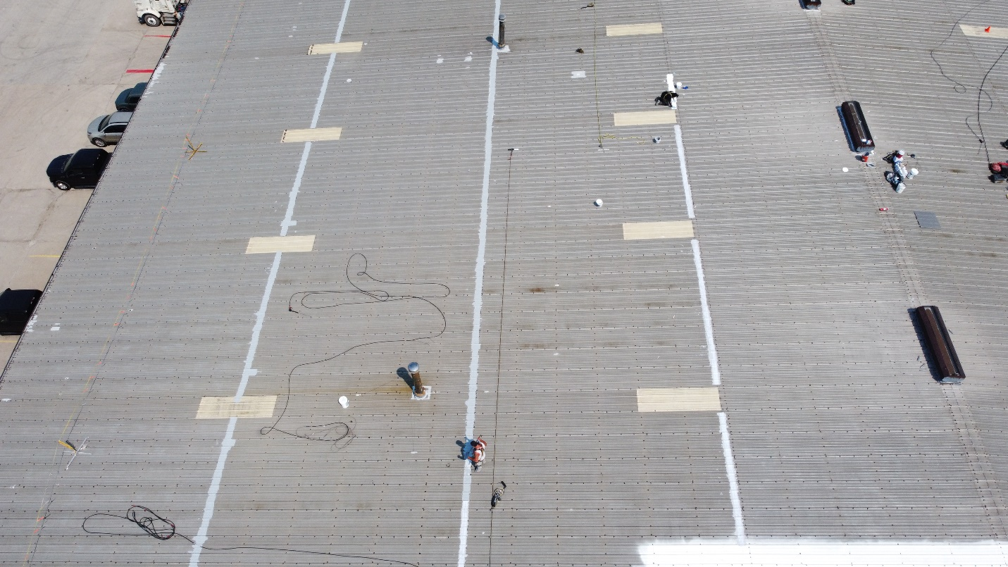 seams being prepared before a roof coating system is installed
