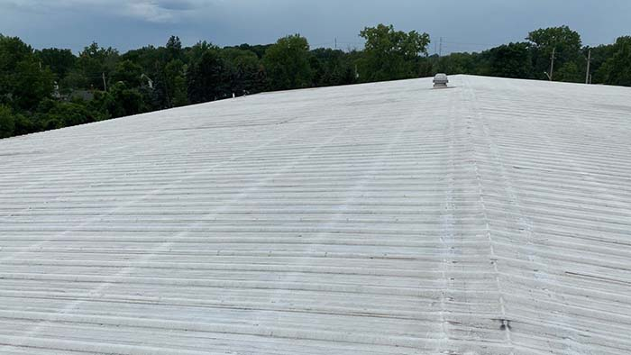 schill roof before a silicone roof coating system