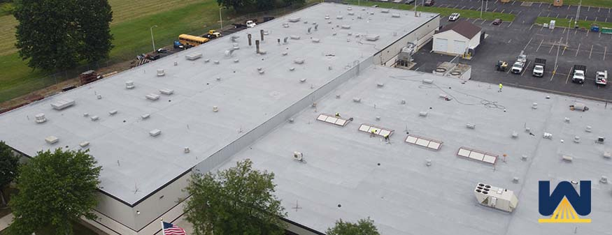 spray foam over roofs with pipes, vents, and HVAC units